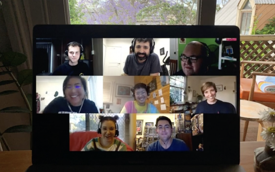 A screenshot from the Make Yourself At Home online experience. It shows a laptop in a bedroom and 8 makers space artists on Zoom smiling mid-conversation